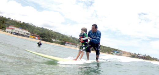 Surfers healing founder, Izzy Paskowiz, gives a camper the ride of his life. Photos by Rachel Tanner Photography.
