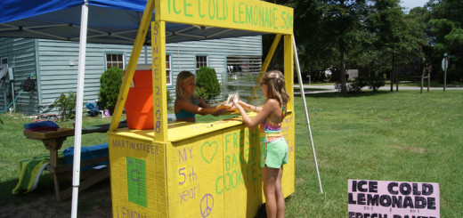 Cassidy Joyce with a customer at her lemonade stand on Martin St. in KDH.