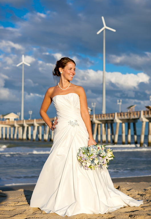 Megan Weber Duke strikes a pose after her beach wedding and reception in Oceanview Hall at Jennette's Pier recently.