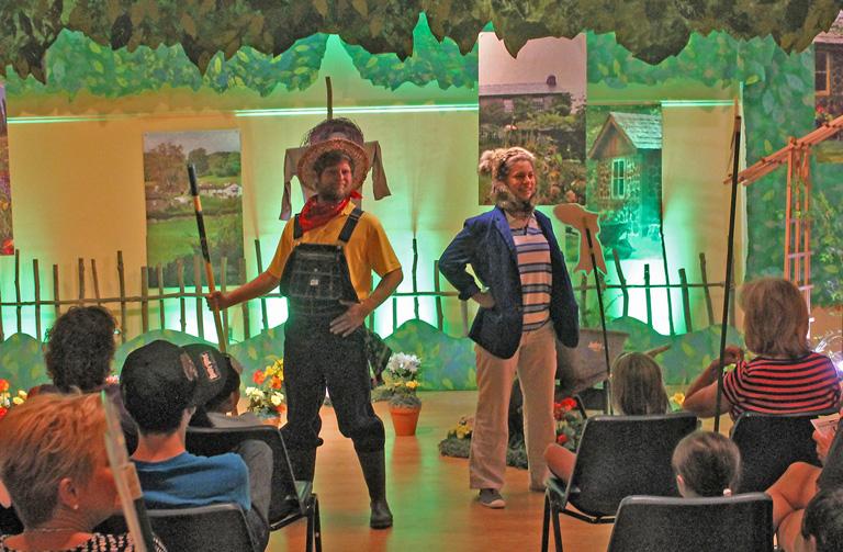 Justin Heavner as Mr. McGregor and Alissa Sumerano as Peter Rabbit.
