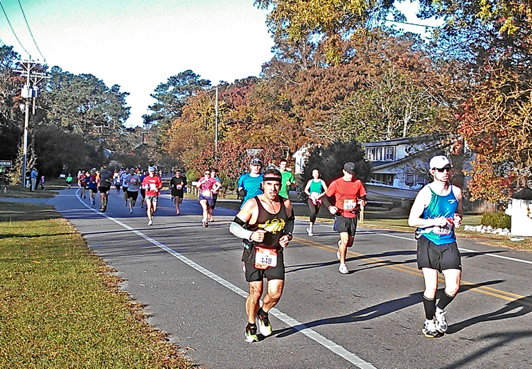 Runners in Kitty Hawk during the 2012 Gateway Outer Banks Marathon.