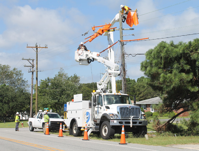 NC Dominion Power crews upgrading transmission lines along Kitty Hawk Road.