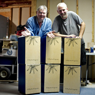 Richard Schreiber and Chris Whitehurst with a stack of cajons.