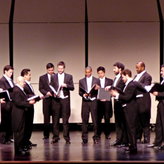 Chanticleer on stage at the First Flight High School auditorium.