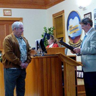 Retiring Mayor Cliff Perry with incoming Mayor Gary Perry (no relation) receiving resolution of appreciation from Kitty Hawk Town Council.