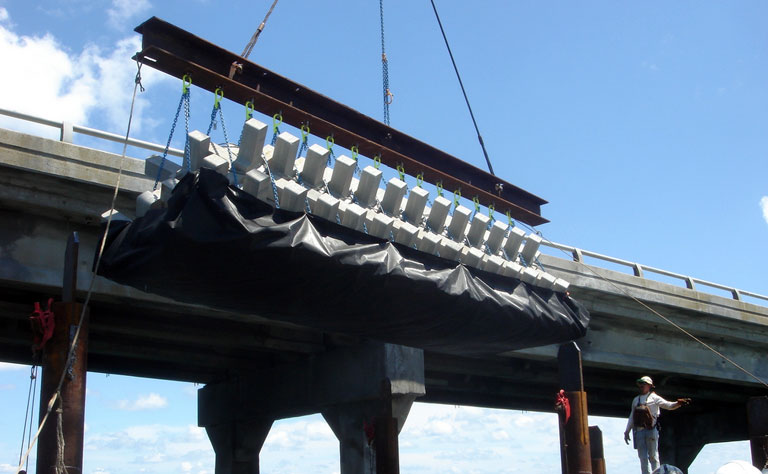 A-jack being installed last year at Bonner Bridge. A-jacks are used to prevent sand scour.