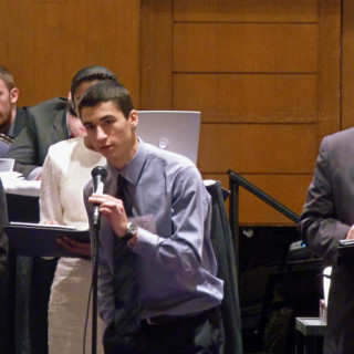 Joseph Lupetin responding to a question about a resolution Togo was co-sponsoring. Trevor Bruce is to the right of him.