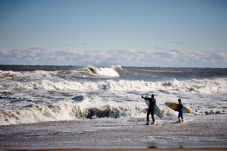 Dressed for cold weather and cold water surfing on the Outer Banks.