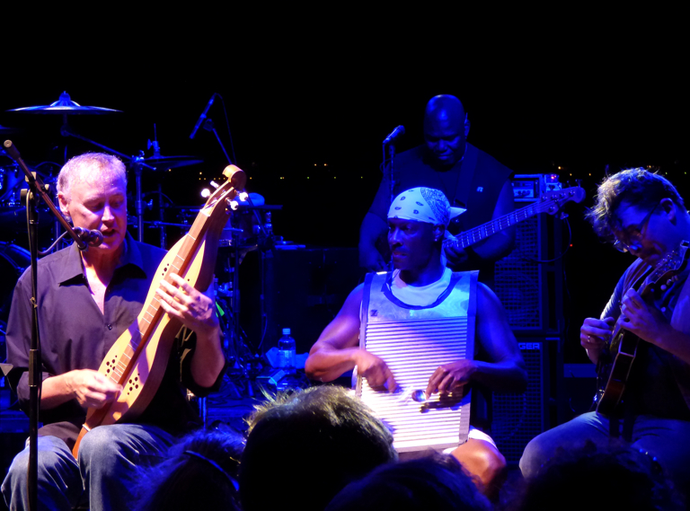 Bruce Hornsby playing dobro with Sonny Emory on washboard and Ross Holmes on mandolin.