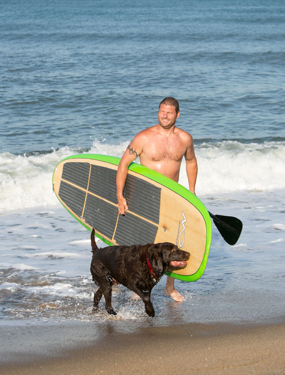 Colin Cox and his pup enjoy the water in Kill Devil Hills.