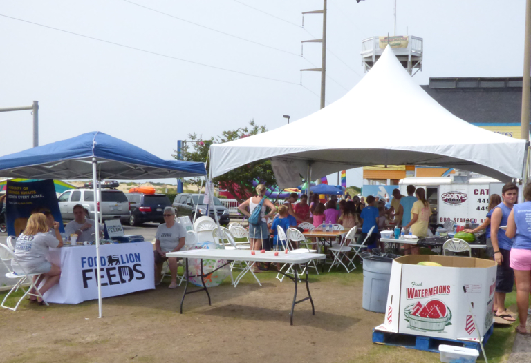 """Food Lion had a table at the Festival to talk about their Food Lion Feeds program. According to South Nags Head Store Manager Rick Chance, through the sale of their """"Food Lion Feeds"""" shopping bags, Outer Banks Food Lions have provided over 12,000 meals this year."""