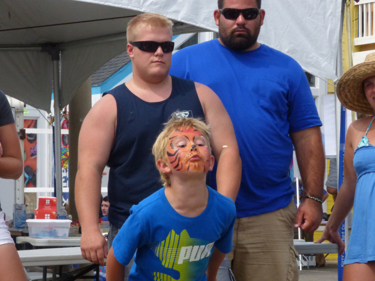 What would a watermelon festival be without a watermelon seed spitting contest? Notice the face painting. This one was good—I saw at least one other that was even more intricate.