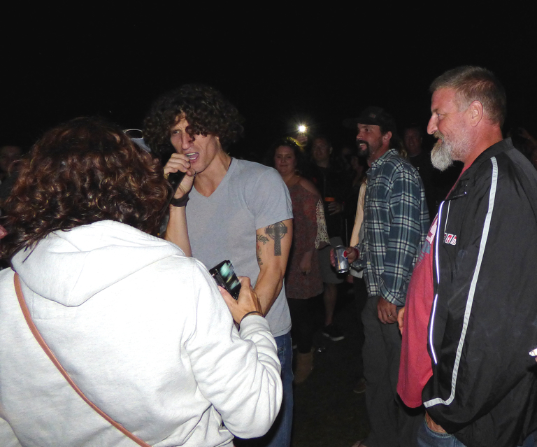 David Shaw of the Revivalists working the crowd.