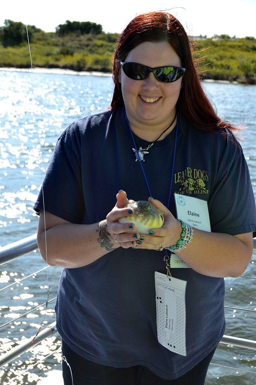 Elaine Lubosch of Dare County holds a fish that she caught on the Crystal Dawn. Photo Credit: Use Jason M. Foster/Thin Blue Line Productions