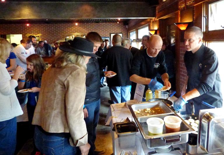 Dan Lewis, Coastal Provisions preparing shrimp and grits.