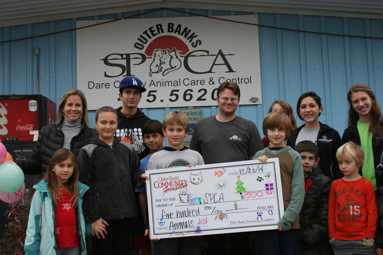 Community Foundation Giving Circle presenting check to the Outer Banks SPCA.