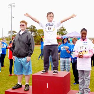 David Vincent celebrating his victory, with Josh Holland (L) and Zarreia Liverman (R).