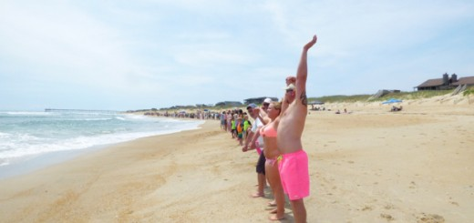 Hands linked at noon in Nags Head for Hands Across the Sand. Photo, Kip Tabb.