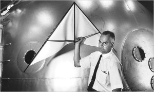 Francis Rogallo posing with a mock-up of an early hang glider.