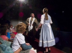 Belle confronting Le Feu about her father's scarf. Action taking place in the middle of the audience.
