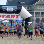 And they're off! Competitors begin running the 2015 Storm the Beach. Photo, Kip Tabb
