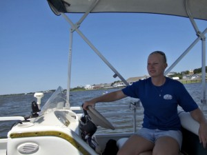 Captain Christine Lester at the helm, leaving Duck.