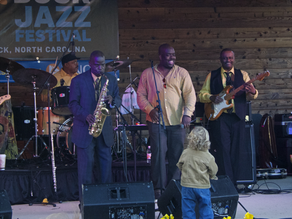 Maceo Parker with young fan at Duck Jazz Festival.  That's Maceo on sax and Bruno Spieght on guitar.