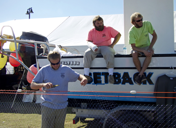 At the Outer Banks Seafood Festival. That's (LtoR)Jake Griffin working on a gill net with  Dalton Wilson and Willie Rawls looking on. Photo Kip Tabb