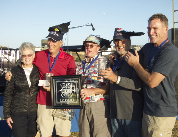 Winning team Loonies on Tap receives their plaque. Pictured: (LtoR) Carol Sparks, daughter of Francis and Gertrude Rogallo, Tom Haddon, Jeff Fischer, Ralph Buxton and Bruce Weaver.