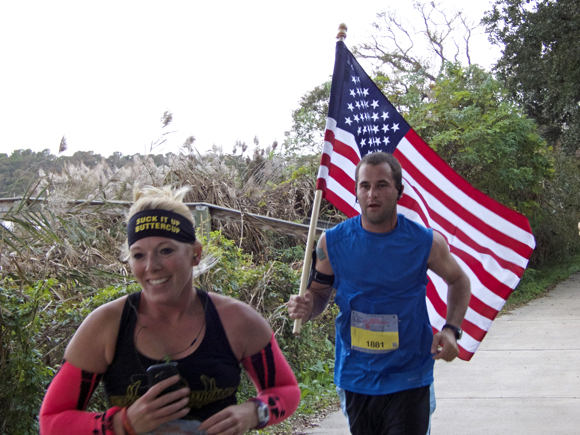 Matthew Cartwright from Hatteras, carrying the American flag throughout the Outer Banks Marathon. Matthew finished with a time of 4:41