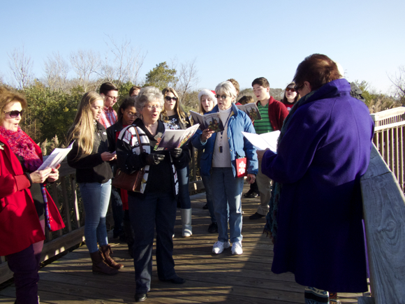 First Flight High School advanced choir and  glee choir caroling on the Duck Boardwalk.