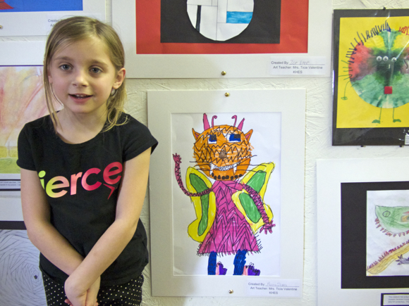Marina Dianna, daughter of NBS writer Lindsey Dianna, posing with her artwork.