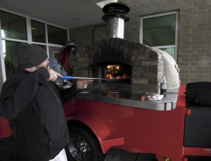 Making pizza at the Corolla Pizza mobile oven, day two. The winter jacket was a necessity.
