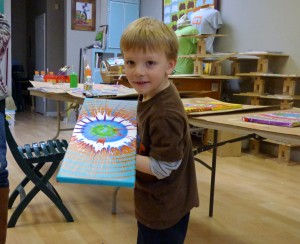 Four-year-old Keegan with his creation. Keegan had to leave before the final picture was taken.