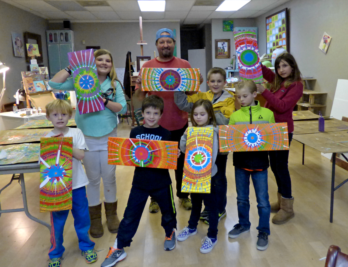 Artists with their completed masterpieces. Front Row (LtoR): Jake, Caden, Abby, Seth; Back Row: Bella, Brad Price, Hunter, Reagan. (I hope I have the names in the right order.)