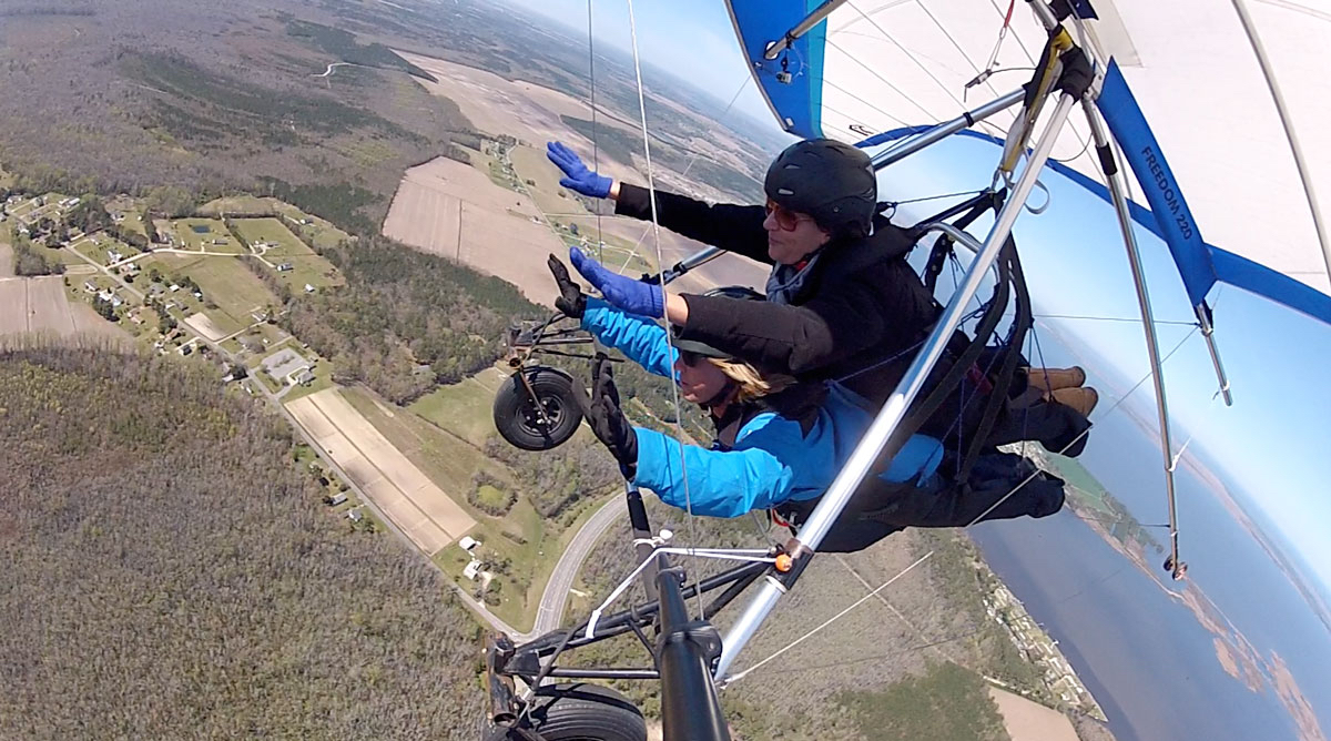 "Hang gliding instructor Andy Thompson and Amelia Boldaji fly ""hands off"". The glider will fly itself."