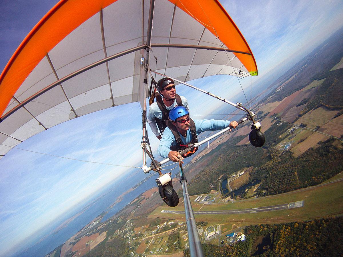 Veteran Kitty Hawk Kites hang gliding instructor Jonny Thompson in flight.