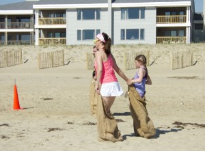 Mother and daughter in sack obstacle.