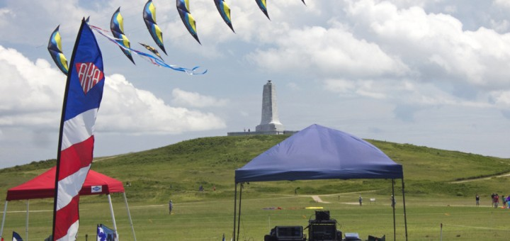 A stack of two line delta kites flying in the kite area. Photo, Kip Tabb
