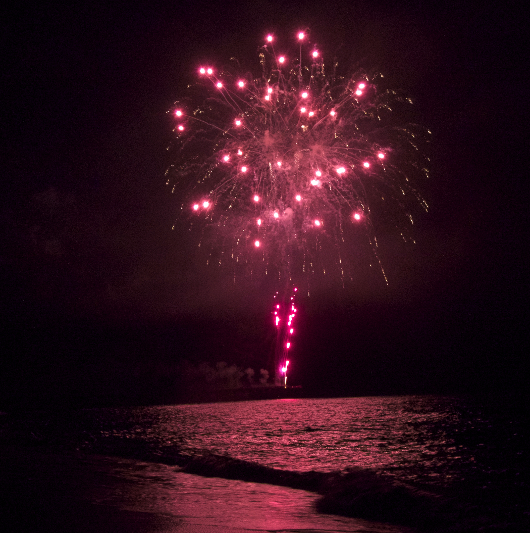 Fireworks reflected on the waters of the Atlantic Ocean.