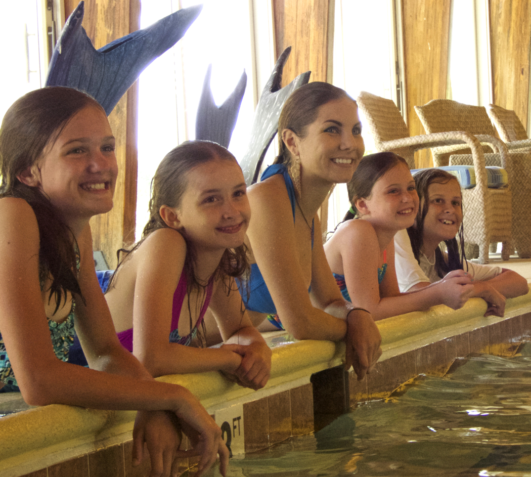 Mermaids and King Triton on the end. Hannah Burgess, professional mermaid and instructor, is second from the left.
