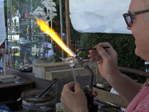 Curtis Cecil creating a glass bird.