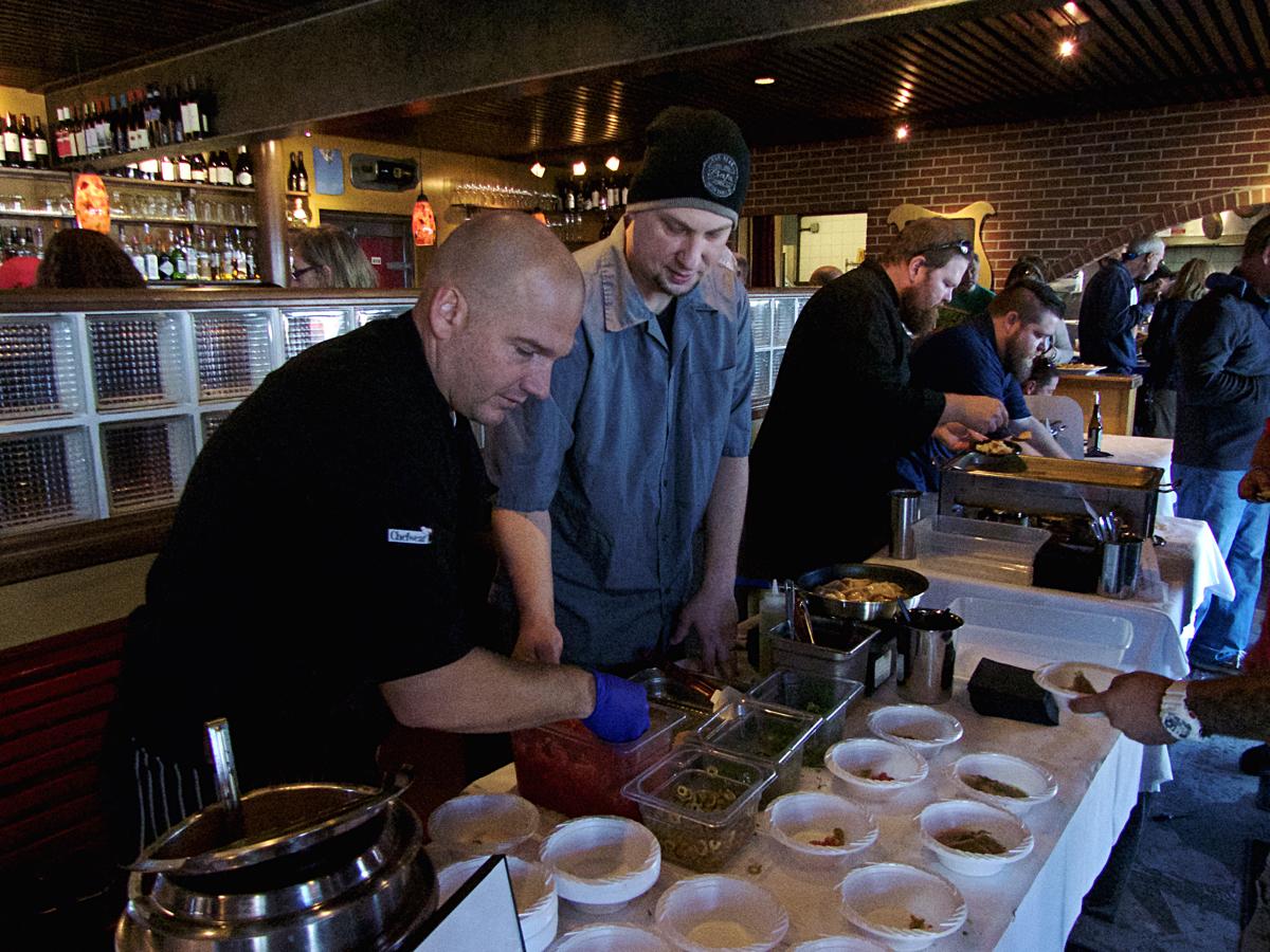 Rob Robinson (left) and Matt Payne of Bad Bean with their Shrimp Veracruz Dumpling with Shrimp Broth.