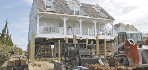 Hollerman house being moved back from the sea.