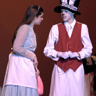 "Alice (Maiah Tabb) and the White Rabbit (Sean McGuire) in the First Flight High School production of ""Alice in Wonderland."""