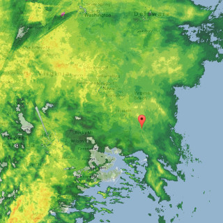 Radar image captured from Weather Underground at approx. 5:50 p.m. The red flag is KDH.