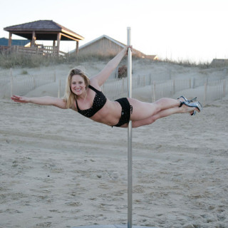 Chel Rogerson pole dancing on the beach. Photo K. Wilkins Photography