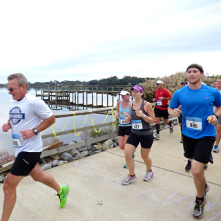 Runners along Kitty Hawk Bay in Kitty Hawk.