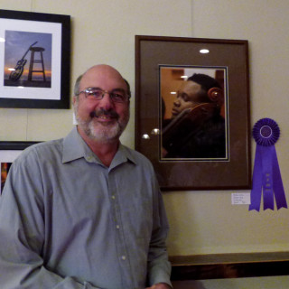 Judge's Award winner, George Wood with his photograph Mellow Cello.