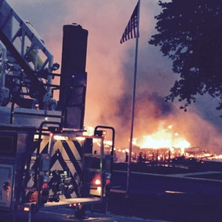 Brindley Beach Corolla office in flames, Friday, June 12, 2015.